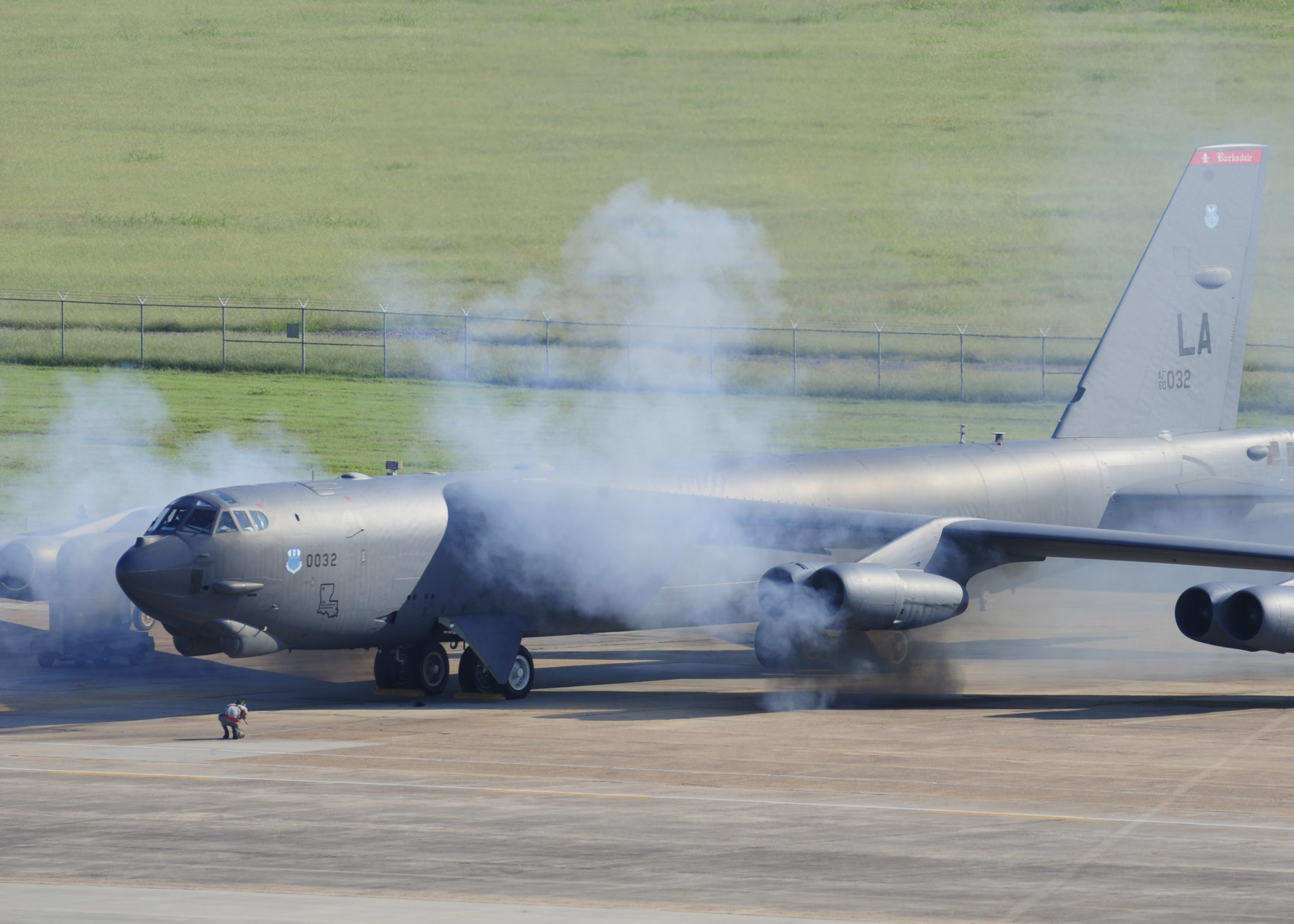 A B-52H Stratofortress starts its engines during a Minimum Interval Takeoff on Barksdale Air Force Base, La., Aug. 14, 2014. Common place during the Cold War, a MITO challenges crews to get multiple aircraft airborne as quickly as possible in response to an alert call. (U.S. Air Force photo/Staff Sgt. Sean Martin)